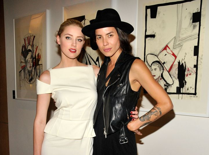 "Amber Heard and then-girlfriend Tasya Van Ree, an artist and photographer, at Van Ree's  ""Distorted Delicacies"" exhibit"