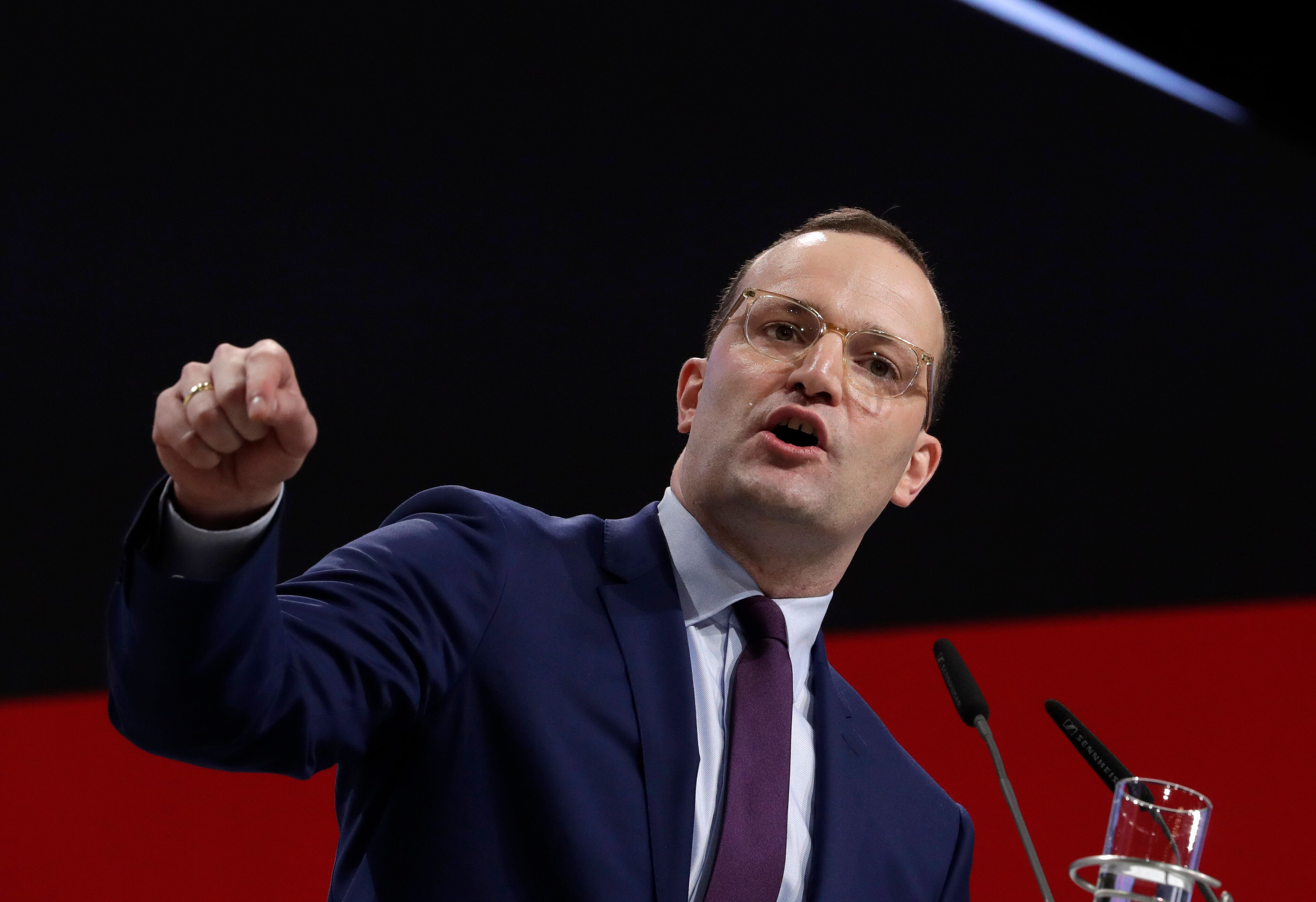 German Health Minister Jens Spahn delivers his speech when running as chairman at the party convention of the Christian Democratic Party CDU in Hamburg, Germany, Friday, Dec. 7, 2018. 1001 delegates are electing a successor of German Chancellor Angela Merkel who doesn't run again for party chairmanship after more than 18 years at the helm of the party. (AP Photo/Michael Sohn)