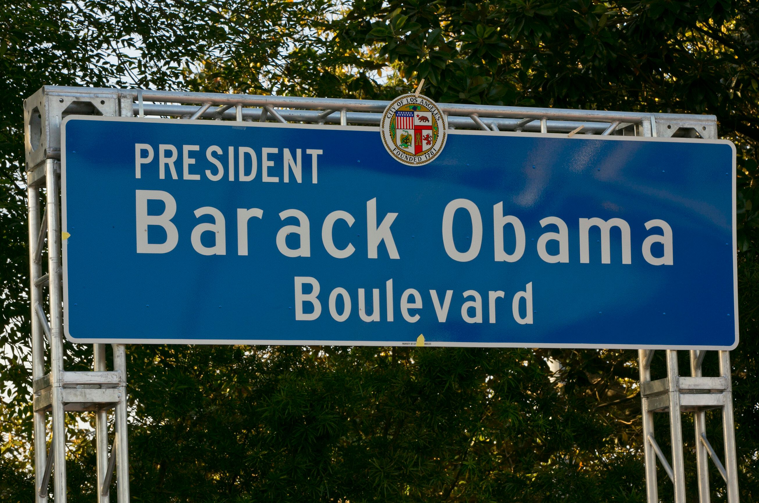 A newly unveiled Obama Boulevard sign is seen in Los Angeles, Saturday, May 4, 2019. A stretch of road in Los Angeles was renamed after former President Barack Obama during a festival and unveiling ceremony Saturday.  The Obama Boulevard will replace Rodeo Road, a 3 ½-mile street that runs across the city's historic black neighborhood.  (AP Photo/Damian Dovarganes)