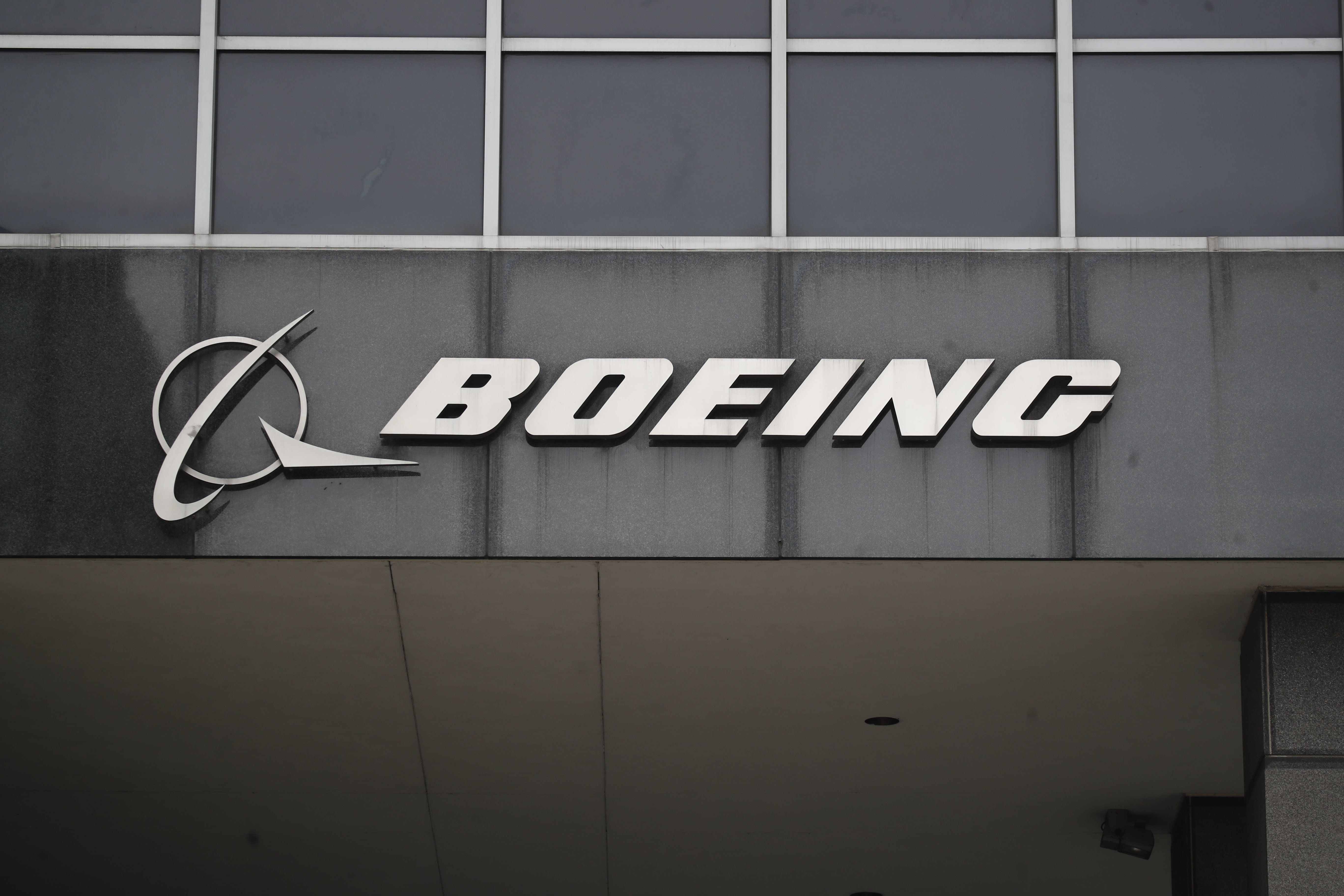 "CHICAGO, March 13, 2019 -- Photo taken on March 13, 2019 shows the Boeing logo at its headquarters in downtown Chicago, the United States. U.S. aircraft manufacturer Boeing said Wednesday it has ""full confidence"" in the safety of its 737 Max aircraft, but it supports action to temporarily ground the entire global fleet of 737 Max ""out of an abundance of caution."" (Xinhua/Joel Lerner) (Xinhua/Joel Lerner via Getty Images)"