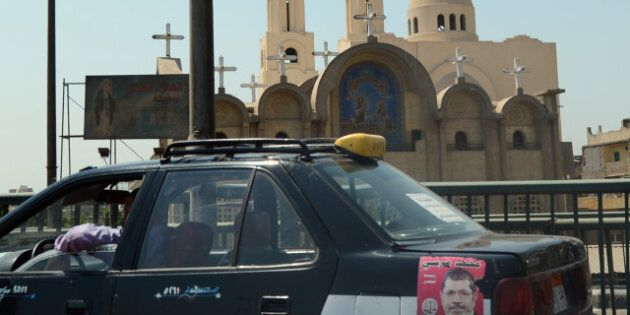 TO GO WITH AFP STORY BY MONA SALEM- A Cairo cab bearing a portrait of Egypt's newly elected President...