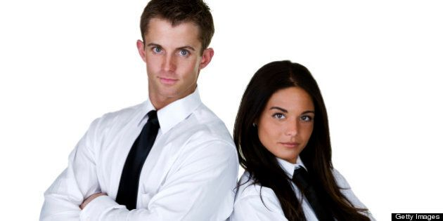 Serious man and woman wearing white shirt and black tie for business concept
