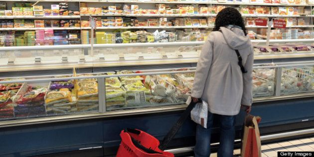 A client looks at products displayed at the frozen products area of a supermarket in Bordeaux, on February...