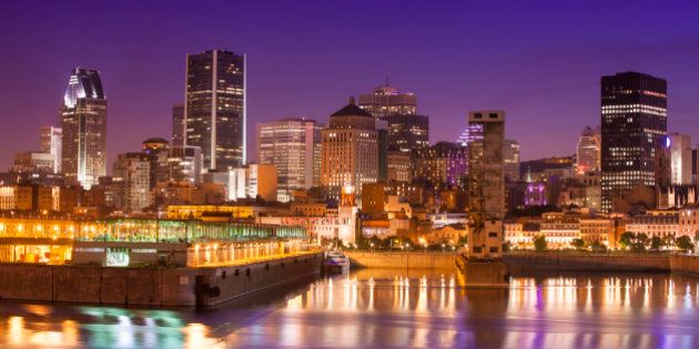 Downtown city skyline at night, showing St. Lawrence River, Montreal, Quebec,