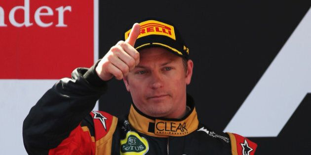 MONTMELO, SPAIN - MAY 12: Kimi Raikkonen of Finland and Lotus celebrates finishing second during the...