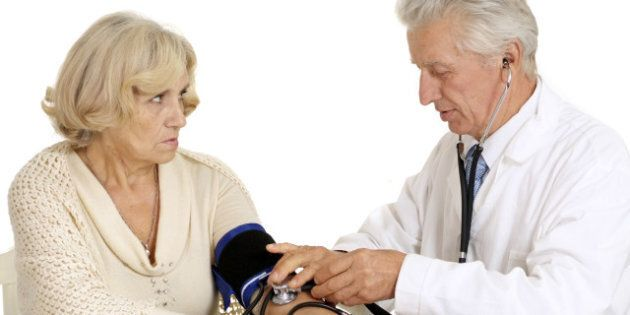 elderly doctor and patient on a ...