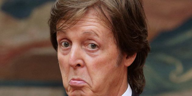 Former Beatles' singer Sir Paul Mc Cartney gives a thumb up after being awarded by French president as...