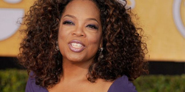 LOS ANGELES, CA - JANUARY 18: Actress Oprah Winfrey arrives at the 20th Annual Screen Actors Guild Awards at The Shrine Auditorium on January 18, 2014 in Los Angeles, California.  (Photo by Gregg DeGuire/WireImage)