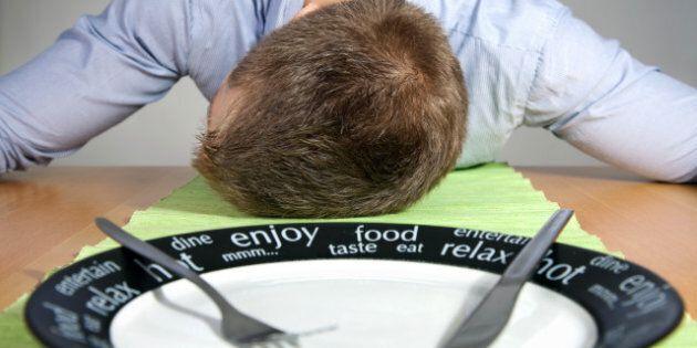 man falls asleep on  a table...