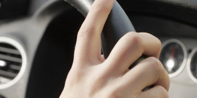 girl hand on wheel steering on...