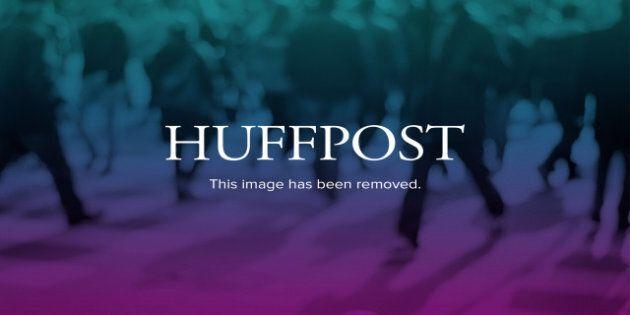 Republican presidential candidate, former Massachusetts Gov. Mitt Romney and President Barack Obama walks...