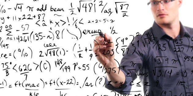 man writes mathematical...
