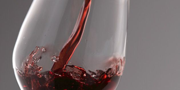 pouring red wine into the