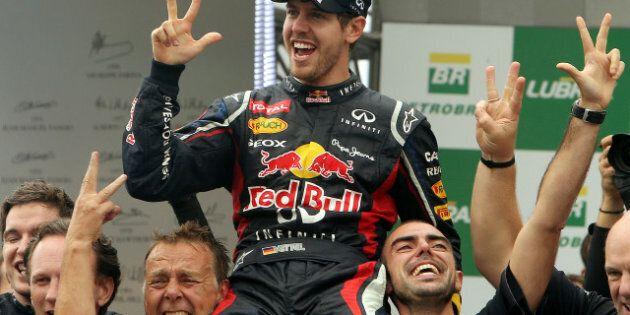 Vettel champion pour une 3e année de suite; Button l'emporte au