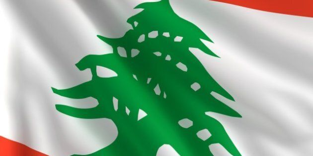 a flag of lebanon in the wind
