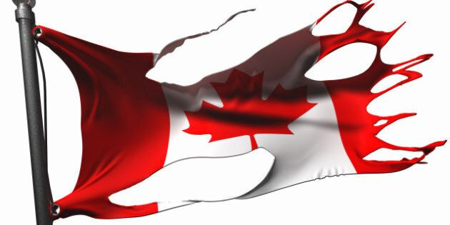 tattered canadian flag on