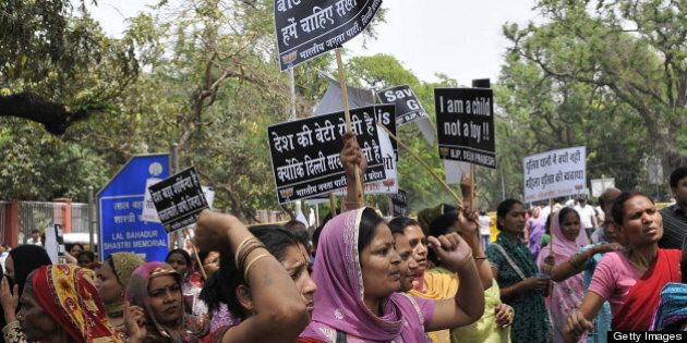 NEW DELHI, INDIA - APRIL 21: Activists of Bharatiya Janata Party shouts anti Government slogans outside the UPA Chairperson Sonia Gandhi's residence during a demonstration against the rape of a five-year old girl on April 21, 2013 in New Delhi, India. A five year girl went missing on April 15 and was found on April 17 in same building where she lives with her parents. She was found in serious condition after being brutally raped and tortured with slashed neck and bite marks on her body. The man who lives in that room was arrested in Bihar state on April 20. (Photo by Vipin Kumar/Hindustan Times via Getty Images)