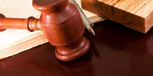 the gavel of justice and a pen...