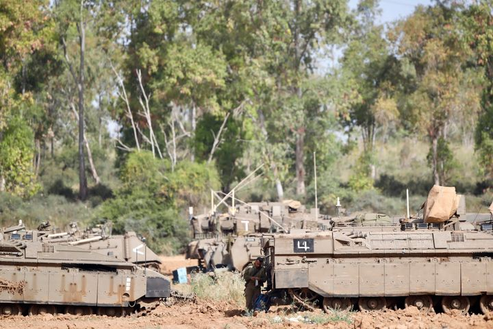 An Israeli soldier stands at a gathering point in Israel Gaza Border on Monday after a ceasefire mediated by Egypt took hold.