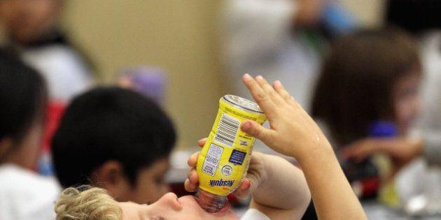 SAN FRANCISCO - NOVEMBER 12: A student at Fairmount Elementary School drinks a bottle of Nesquik chocolate...
