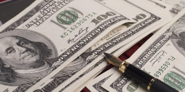 money  pen and calculator