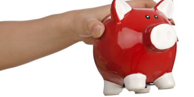 hand with piggybank on