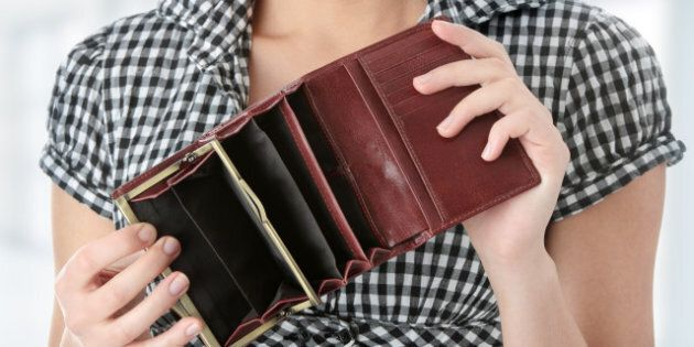 Young caucasian woman with empty wallet -
