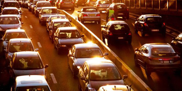 Car traffic against the sunset