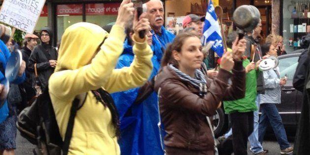 Conflit étudiant: des milliers de manifestants bravent la pluie