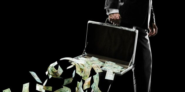 A businessman (35 years old) holding a briefcase at his side and losing an abundance of