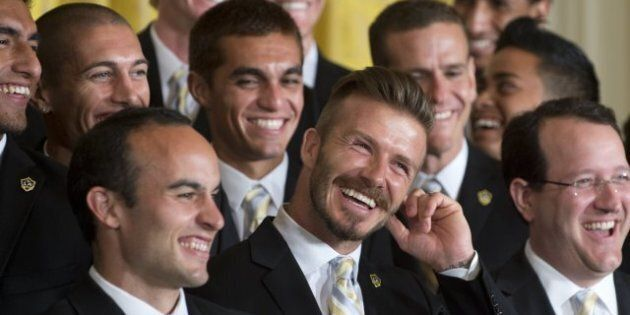 Jeux olympiques: David Beckham porte la flamme et Will Smith amuse la galerie