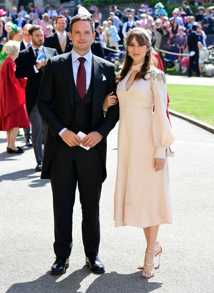 Patrick J. Adams and Troian Bellisario arrive at St. George's Chapel at Windsor Castle before the wedding of Prince Harry to