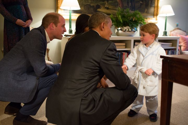 President Barack Obama, Prince William and First Lady Michelle Obama talk with Prince George at Kensington Palace on April 22