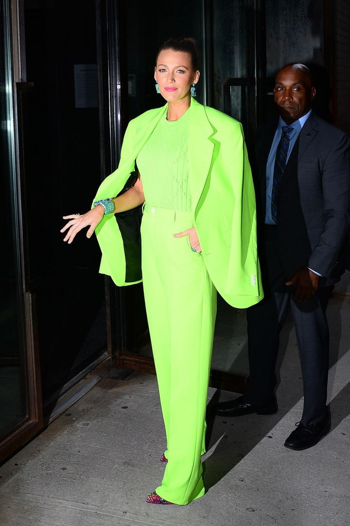 Blake Lively wears a neon suit out in New York on Aug. 17, 2018.