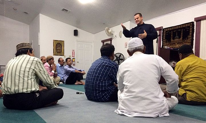 Sheriff's Deputy Nezar Hamze teaches members of the Baitul Mukarram Mosque in Lake Worth, Florida, how to defend themselves i