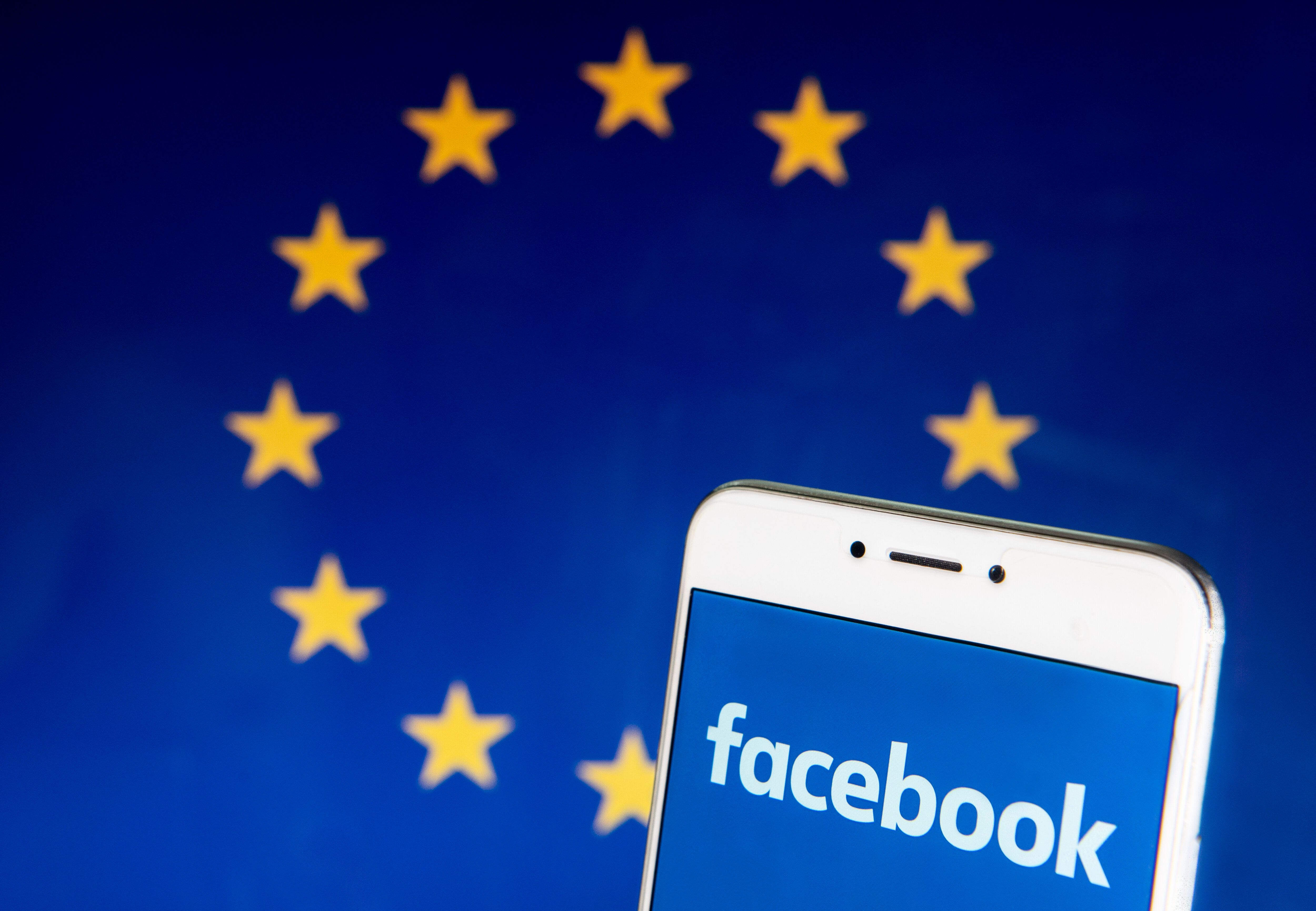 HONG KONG - 2019/04/21: In this photo illustration a American online social media and social networking service company Facebook logo is seen on an Android mobile device with the European Union flag in the background. (Photo Illustration by Budrul Chukrut/SOPA Images/LightRocket via Getty Images)