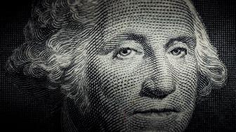 Close up photo of George Washington on One Dollar bill