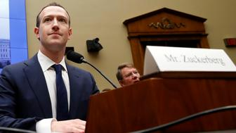 Facebook CEO Mark Zuckerberg returns after a break to continue testifying at a House Energy and Commerce hearing on Capitol Hill in Washington, Wednesday, April 11, 2018, about the use of Facebook data to target American voters in the 2016 election and data privacy. (AP Photo/Jacquelyn Martin)