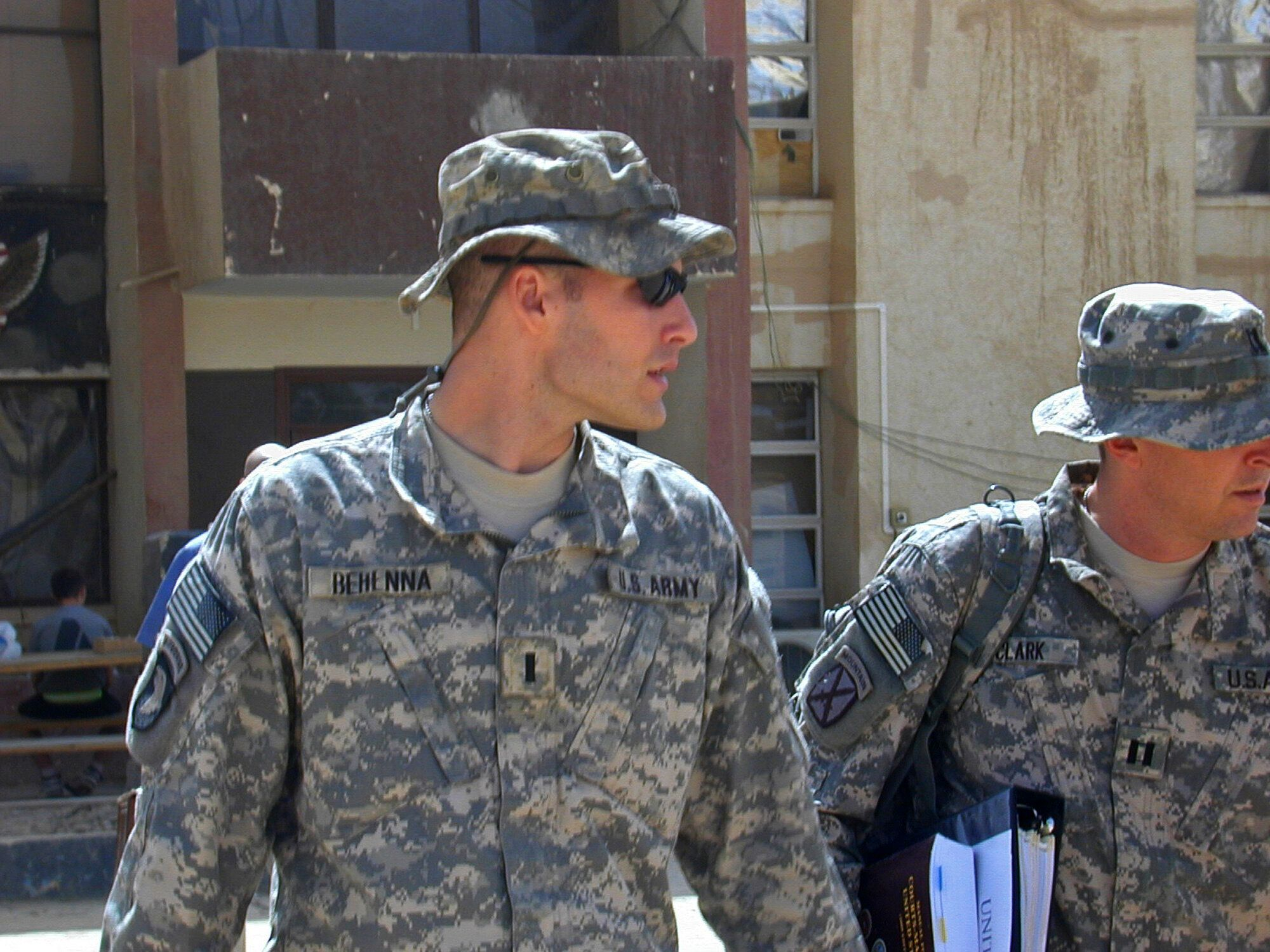 FILE - In this Sunday, Sept. 21, 2008, file photo, 1st Lt. Michael C. Behenna, left, and his defense attorney Capt. Tom Clark, right, walk in Camp Speicher, a large U.S. base near Tikrit, north of Baghdad, Iraq. The White House announced Monday, May 6, 2019, that President Donald Trump pardoned Behenna, a former U.S. soldier convicted in 2009 of killing an Iraqi prisoner. (AP Photo/Vanessa Gera, File)