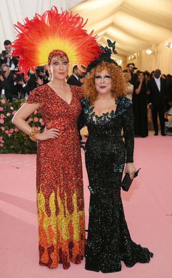 Von Haselberg and Midler wear gowns by Michael Kors Collection.