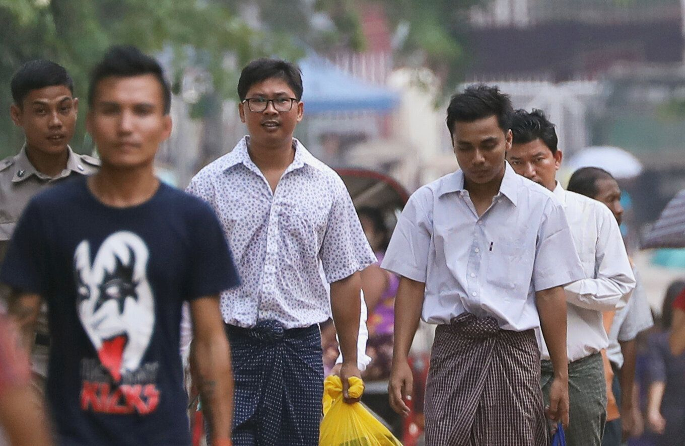 Reuters reporters Wa Lone and Kyaw Soe Oo walk free outside Insein prison after receiving a presidential pardon in Yangon, Myanmar, May 7, 2019. REUTERS/Ann Wang