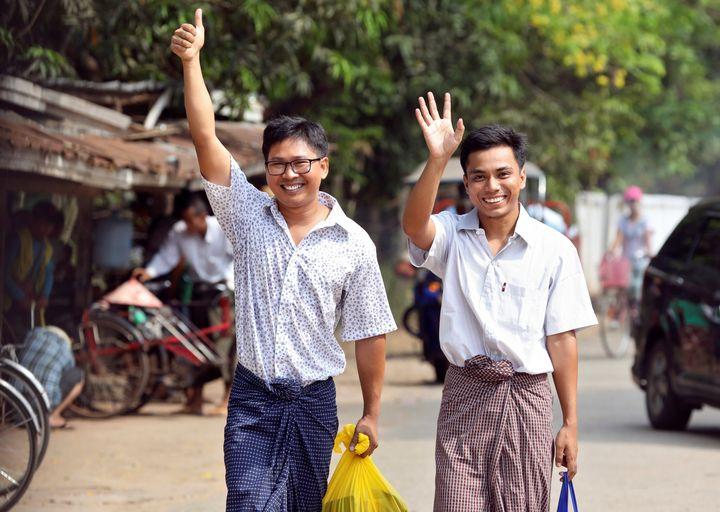 Reuters journalists Wa Lone and Kyaw Soe Oo walk free outside Insein prison after their release in Yangon, Myanmar, on Tuesda
