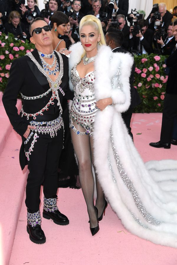 Both wear Moschino designs by Jeremy Scott.