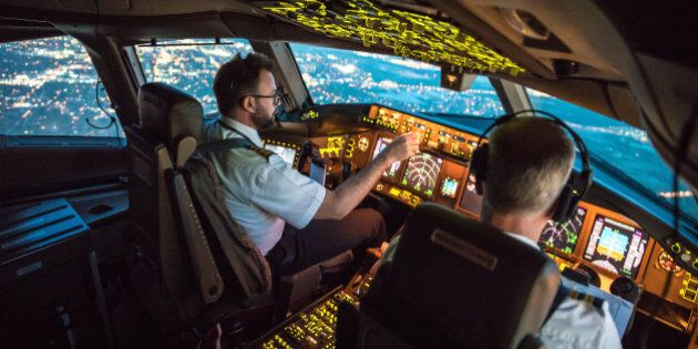 Two pilots at work during departure of Dallas Fort Worth Airport in United States of America. The view...