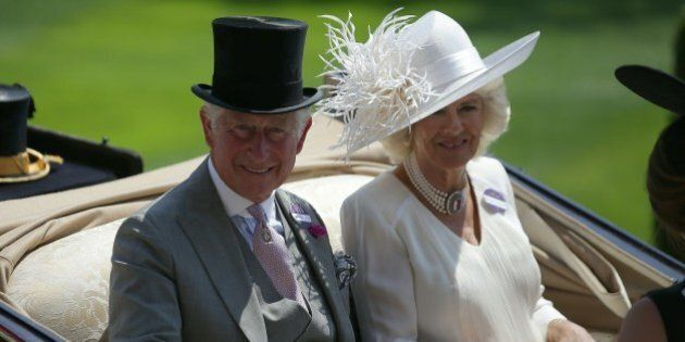 Britain's Prince Charles, Prince of Wales (L) and his wife Britain's Camilla, Duchess of Cornwall travel...