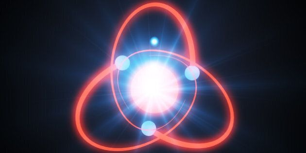3d illustration of a glowing atom on a dark