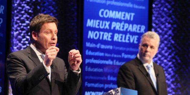 Quebec's Liberal Party leadership candidate Pierre Moreau (L) speaks as Philippe Couillard looks on during...