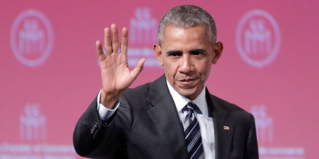 Former U.S. President Barack Obama waves after his keynote speech to the Montreal Chamber of Commerce...