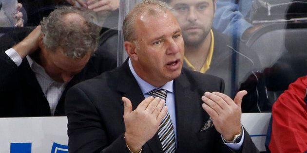 Montreal Canadiens head coach Michel Therrien calls for an official during an NHL hockey game against...