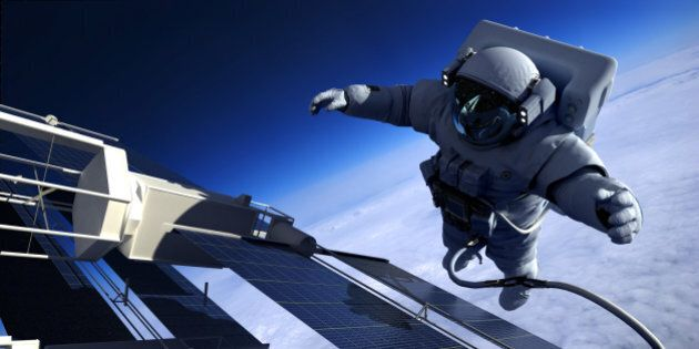 Astronaut and space station in Earth lanshafty background. 'Elemen ts of this image furnished by